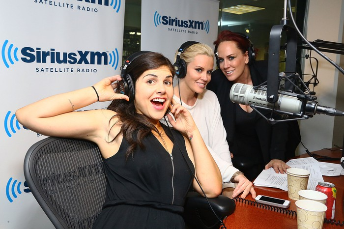 Jenny McCarthy posing at the microphone with two other women while on the air for her Sirius XM show.