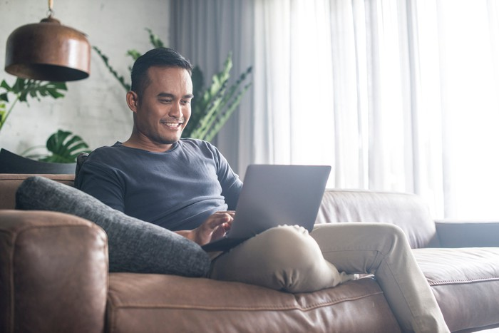 Man at laptop on couch