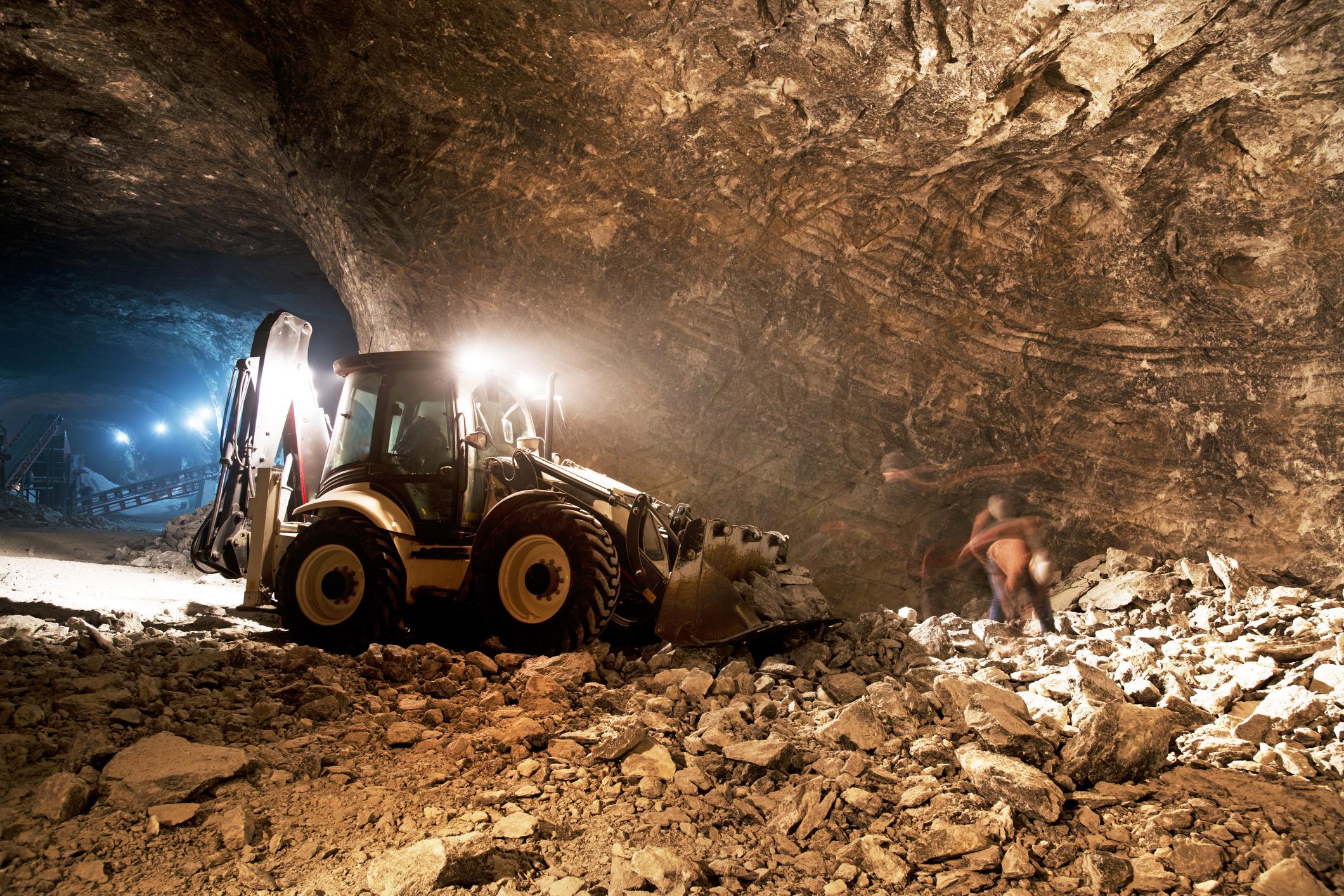 An underground excavator operating in a precious-metal mine.