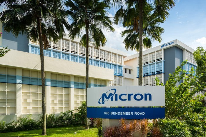 Micron logo on a sign in front of an office building.