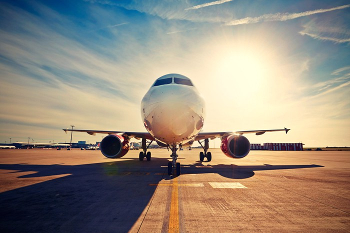 A commercial airplane on the runway preparing for takeoff.