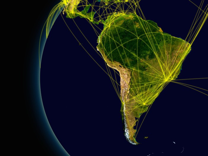 Image of South America with connecting flight patterns to other continents.