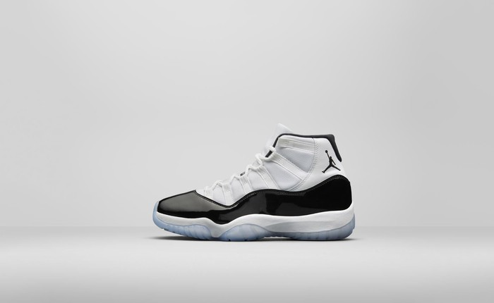 Air Jordan 11 Concord basketball shoe in white with a black patent leather stripe along the side.