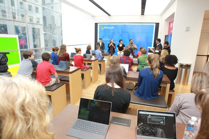 Children in a Microsoft store during a coding event.