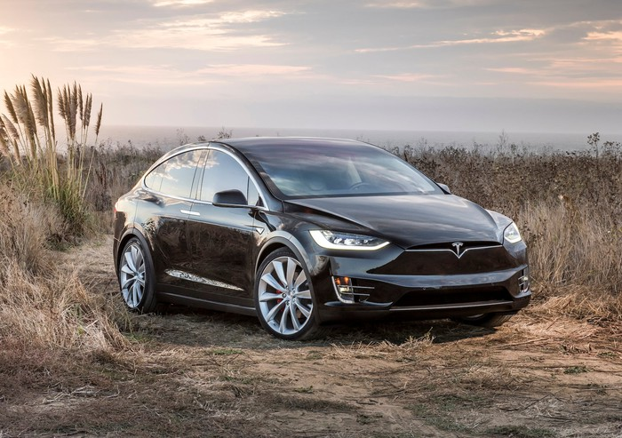 A black Tesla Model X, a 7-passenger luxury SUV.