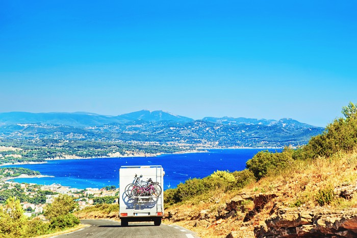 RV driving down scenic road in the south of France coastal region.