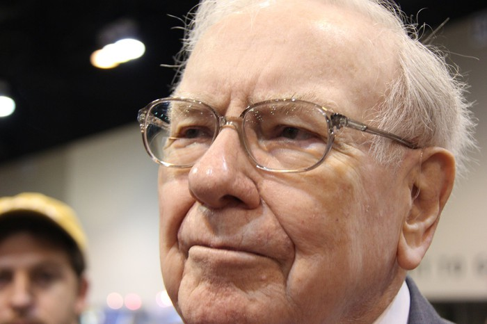 Warren Buffett speaking with reporters during Berkshire Hathaway's annual shareholder meeting.