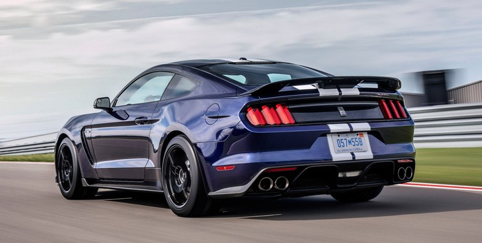 A dark-blue 2019 Ford Mustang Shelby GT 350, a high-performance coupe, on a racetrack.