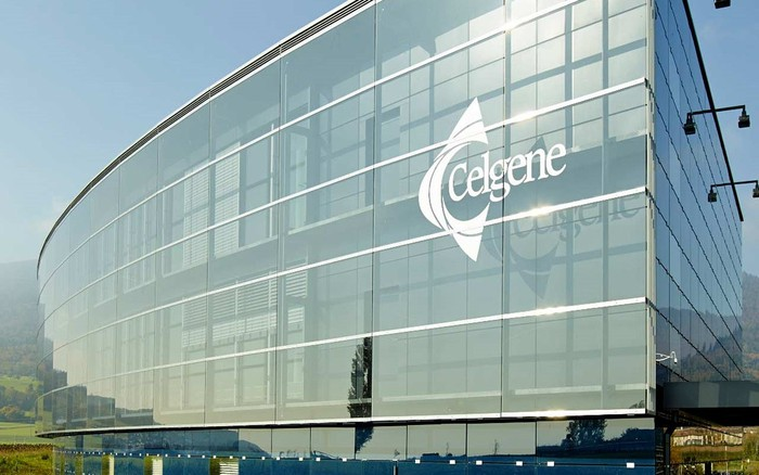 Four-story building with glass front with Celgene logo on it.