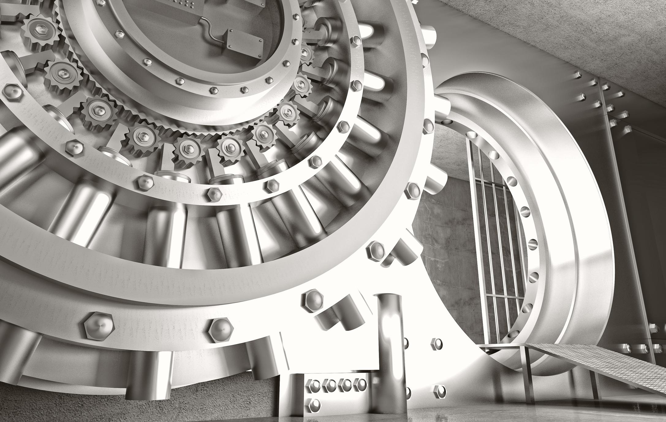 Silver-colored bank vault and huge vault door.