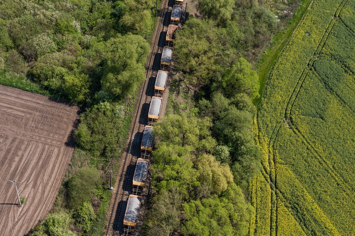 Aerial view of cargo train on track.