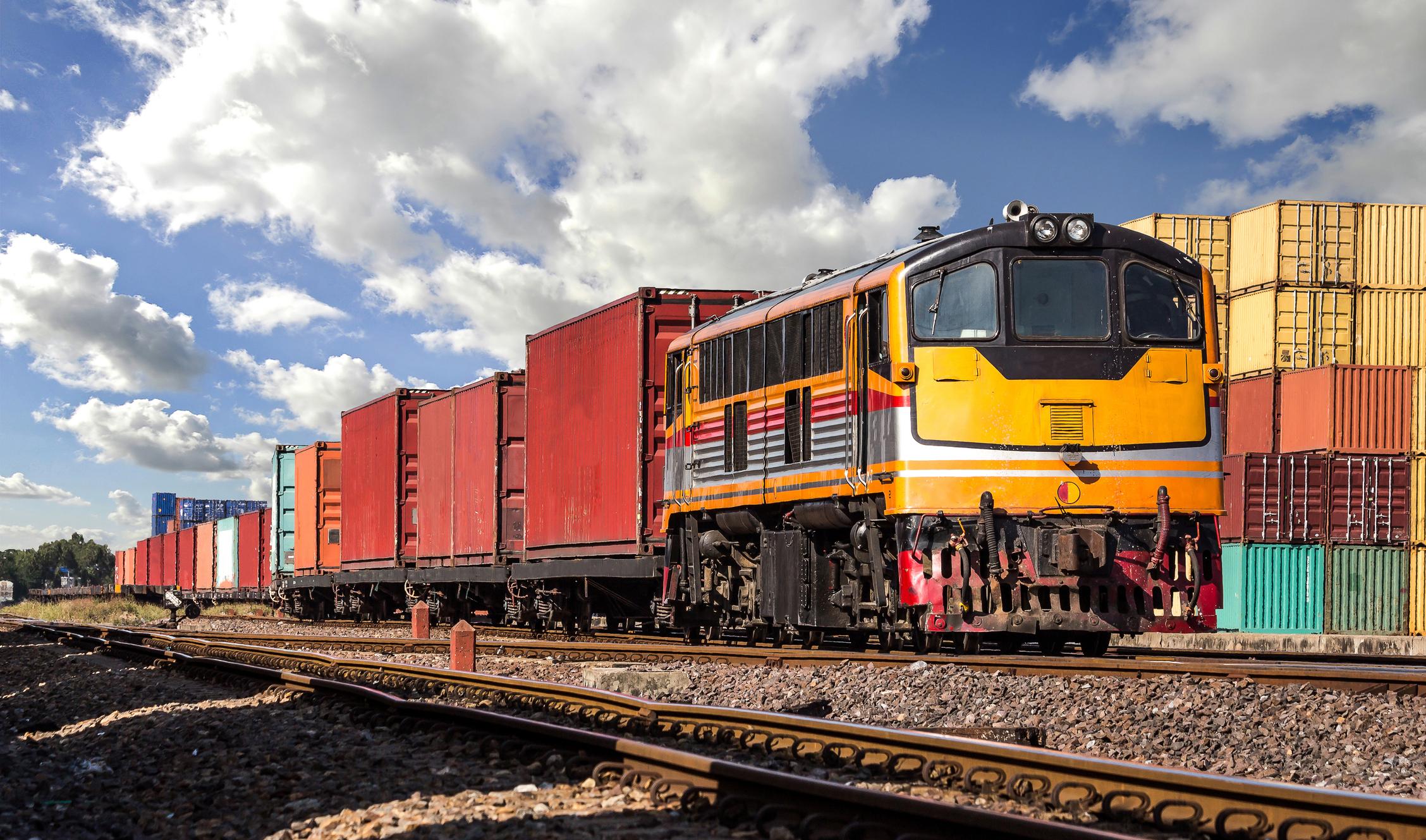 A train moving through an industrial area.