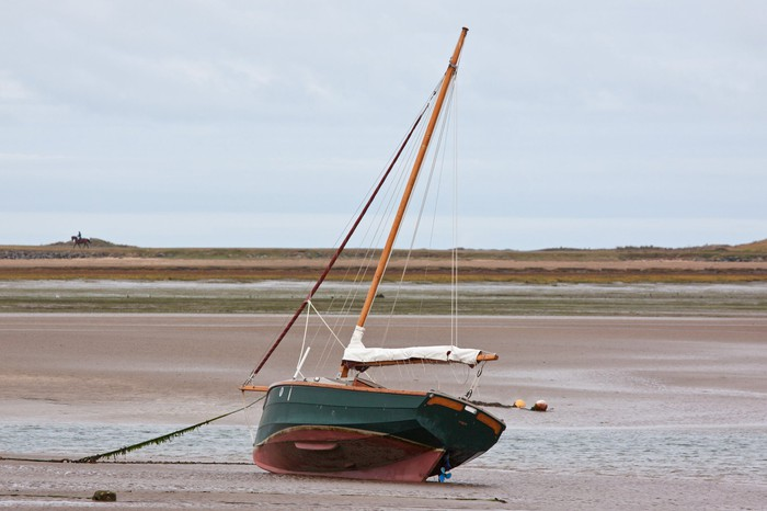 Sailboat beached by ebb tide.