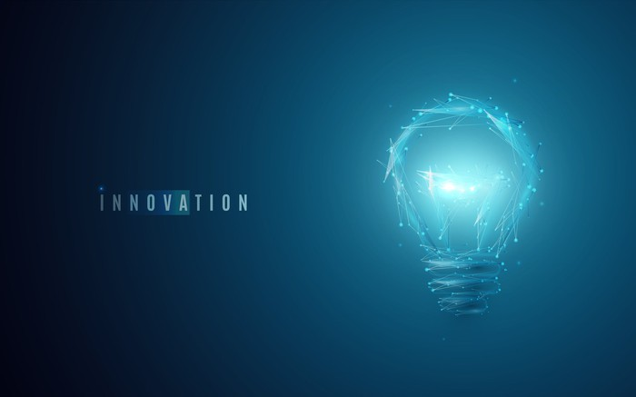 A light bulb shining next to the word innovation