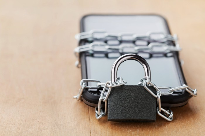 Smartphone wraped in chains and a lock.