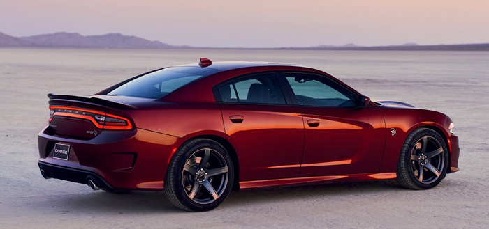 A dark red 2019 Dodge Charger SRT Hellcat, a full-size high-performance sedan, in a desert setting.