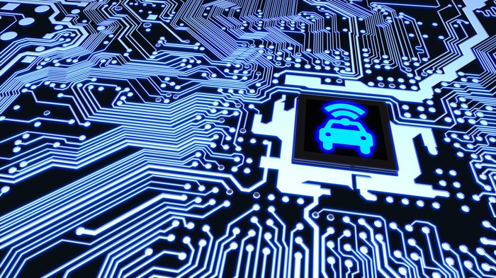 An image of a car with a Wi-Fi signal coming out of it is printed at the center of a computer chip