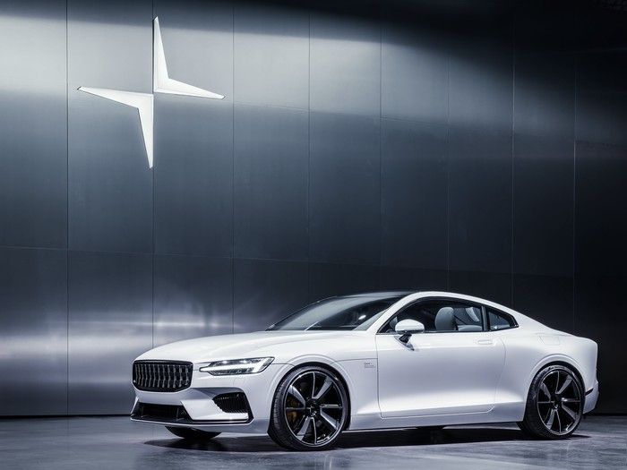 The two-door plug-in hybrid coupe Polestar 1, displayed in a showroom in white
