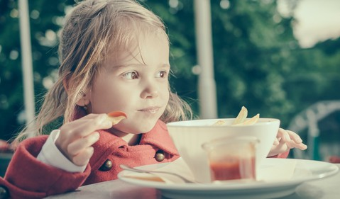 child eating fries