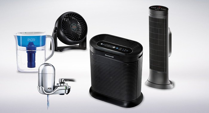 A water purifier system and three fans against a white backdrop.