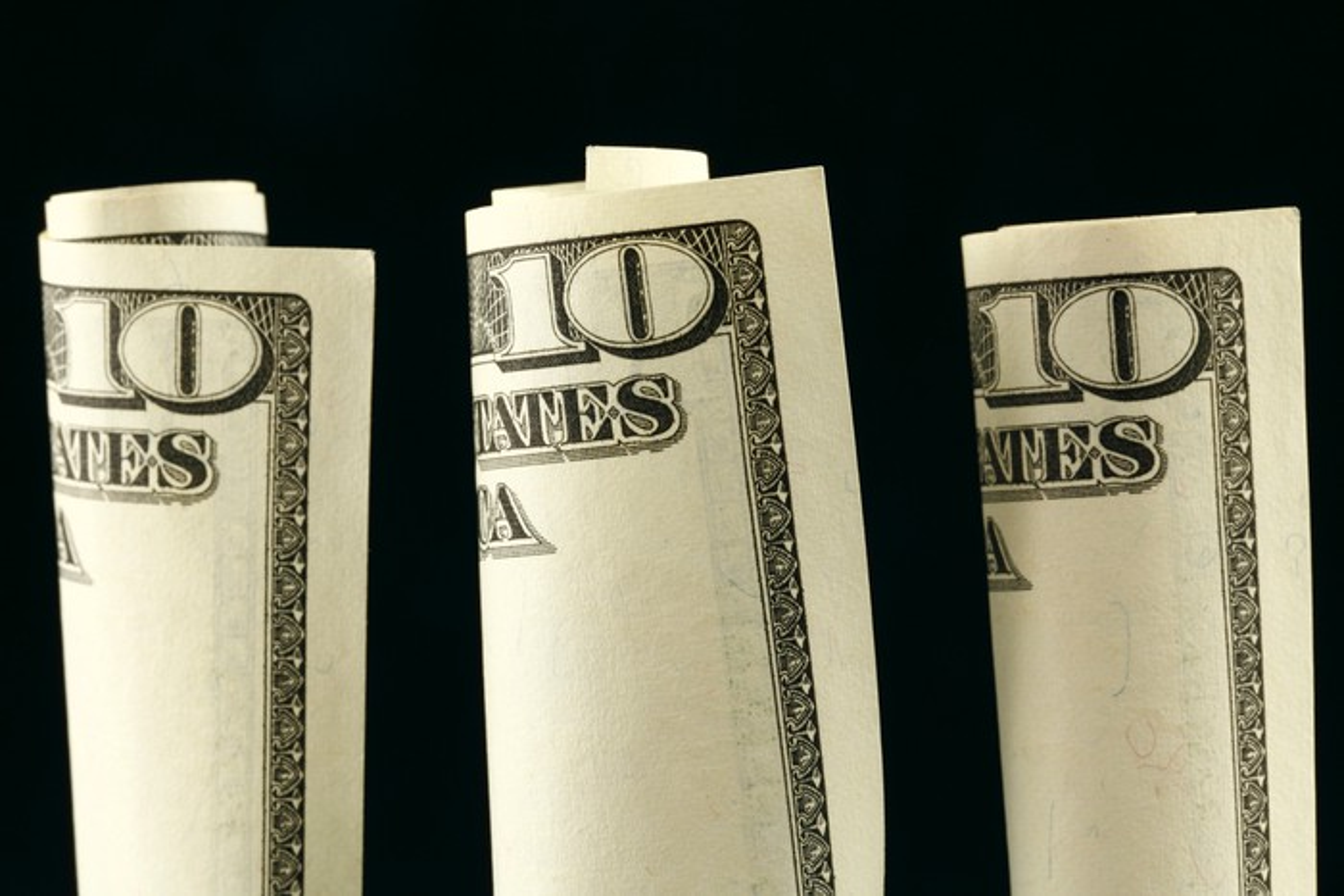 Three rolled-up $10 bills.