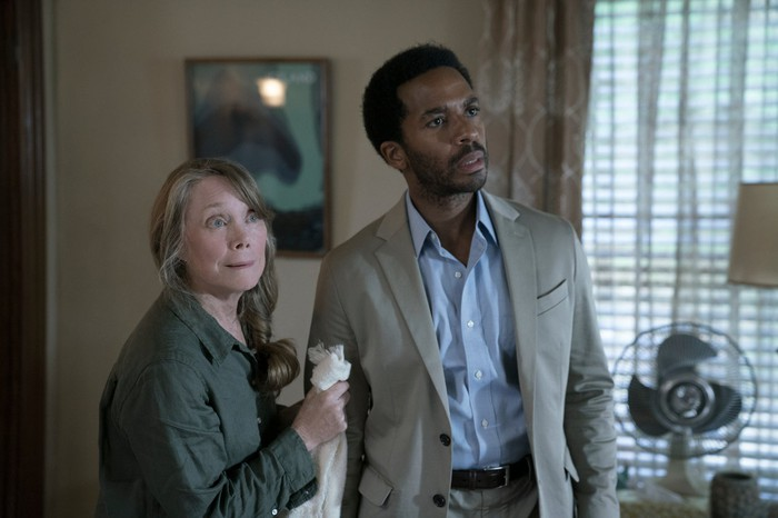 Sissy Spacek and Andre Holland, in character in a scene, looking shocked.