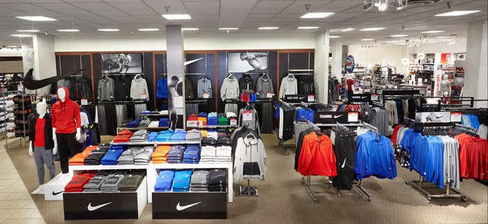 A Nike boutique inside a J.C. Penney story has shirts and jackets on sale.