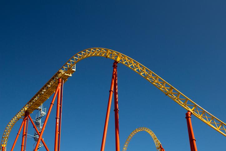 A roller-coaster against a blue sky.