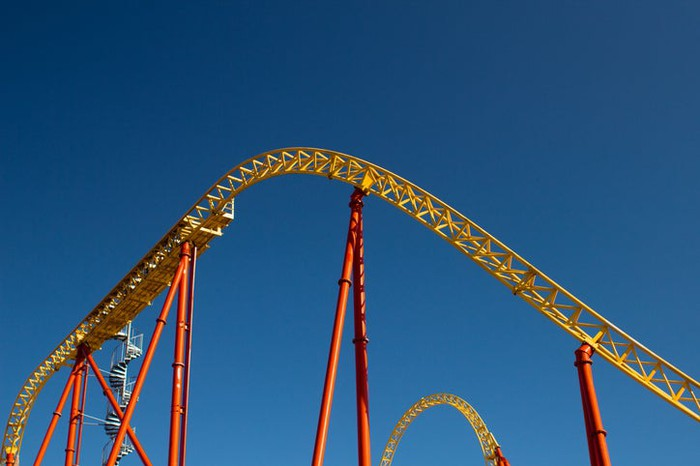 A roller-coaster against a blue sky.