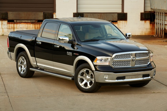 A black and gold 2014 Ram 1500 EcoDiesel, a full-size pickup powered by a diesel engine.
