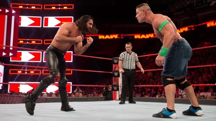 Seth Rollins and John Cena in a WWE ring