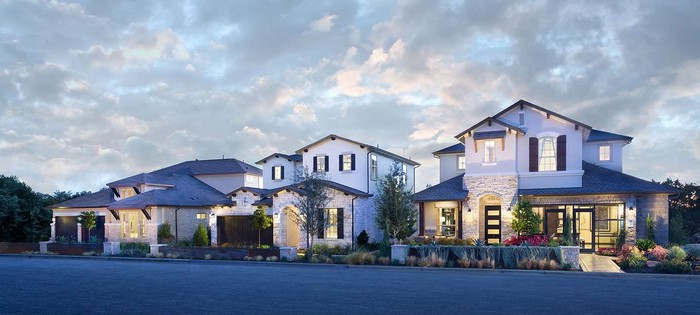 Two Lennar model homes lit up side by side