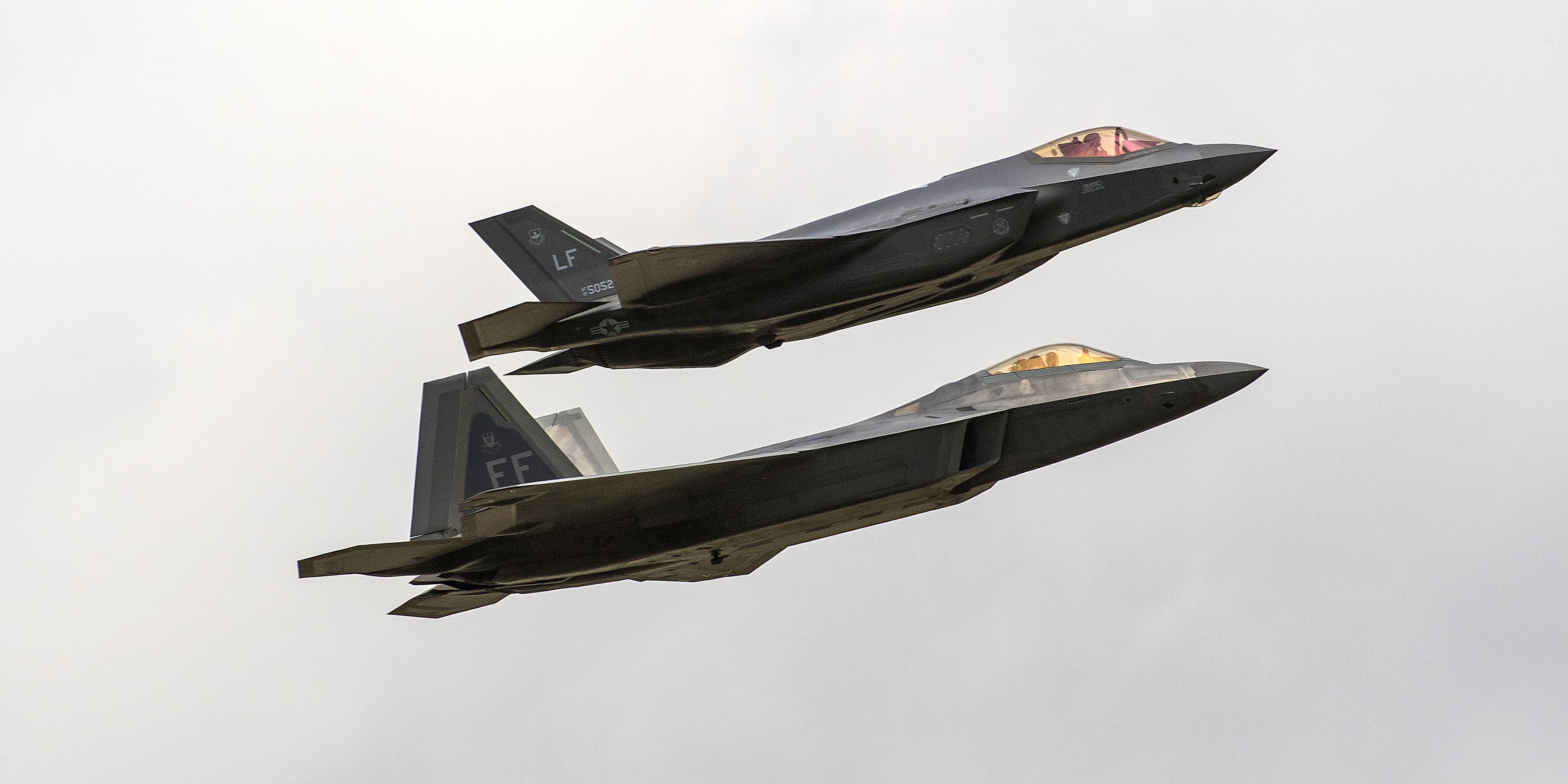 Lockheed Martin-made F-22 and F-35 warplanes together in flight.