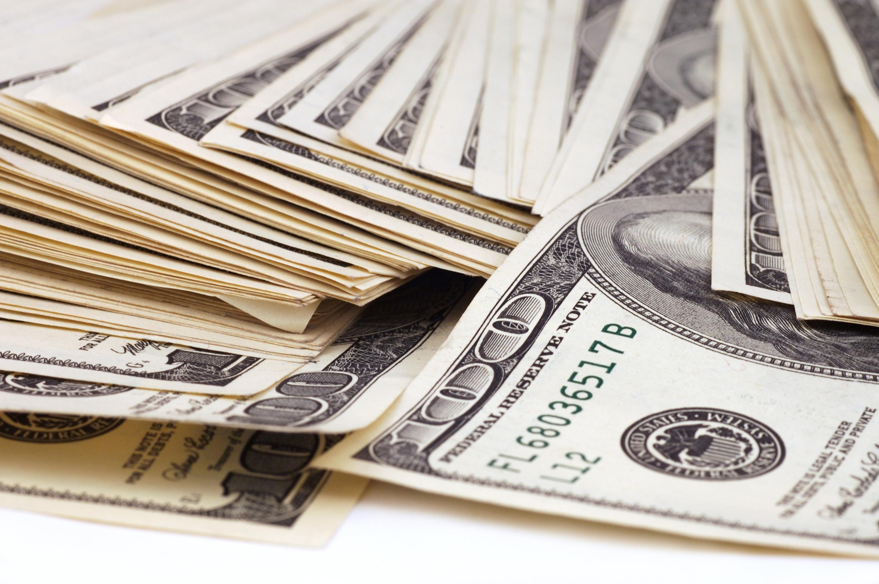 Messy stack of hundred-dollar bills.
