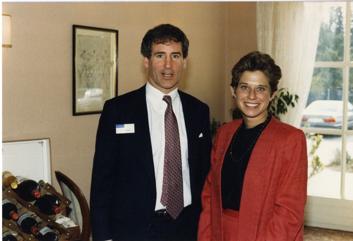 Bill Campbell and Donna Dubinsky standing together, posing for a photo, when both were still at Apple.