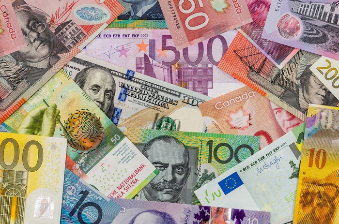 Various foreign currencies laid on top of each other.