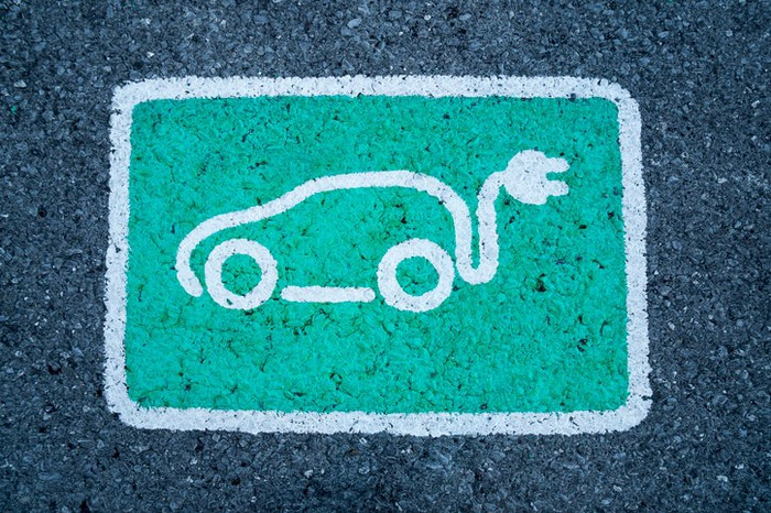A drawing of an electric car on pavement.