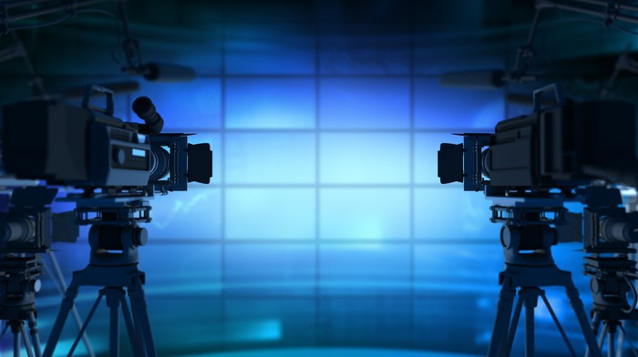 Two cameras set up on a TV set