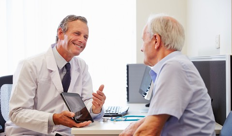 doctor-patient-consultation-with-tablet-getty