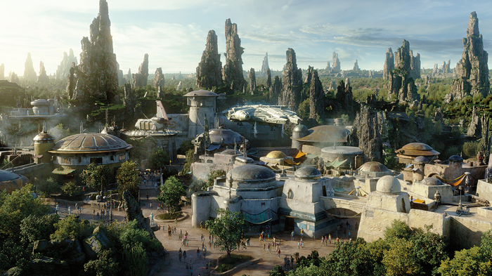 An overhead view of a Star Wars-themed area depicting a small town set in an other-worldly place with strange rock formations in the background.