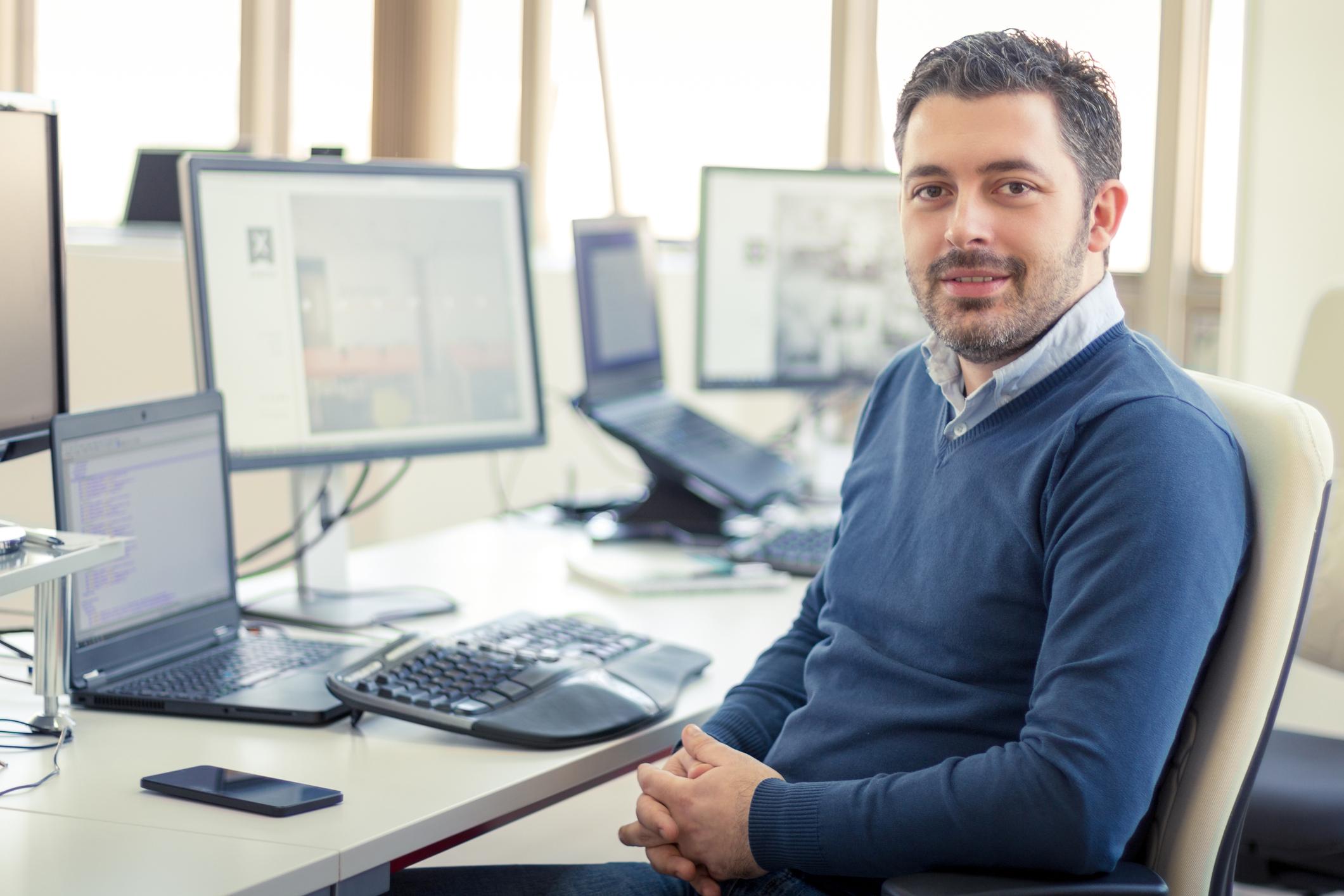 Smiling man at office desk