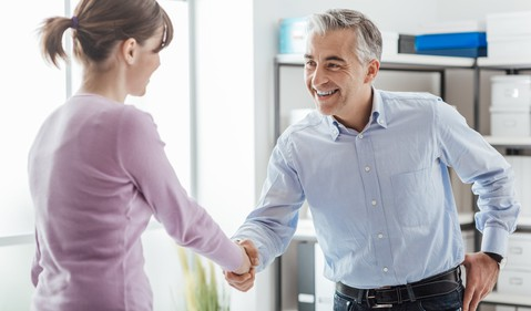 man and woman shaking hands_GettyImages-904657466