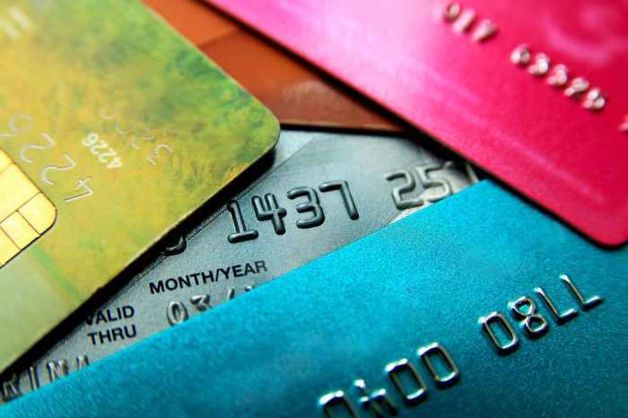 Close-up of loosely stacked credit cards of varying colors.