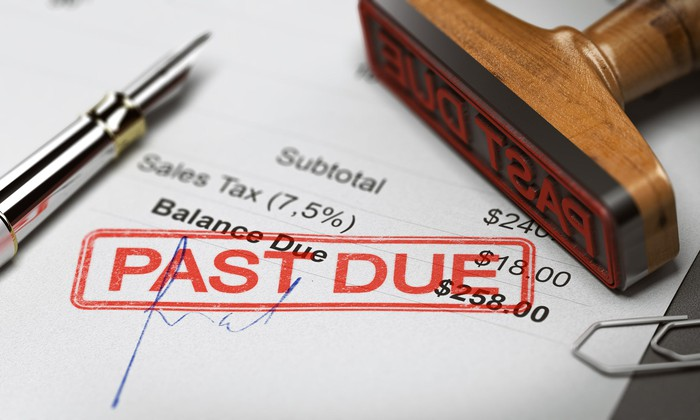 "A balance statement that has been stamped with red ink reading ""PAST DUE."""