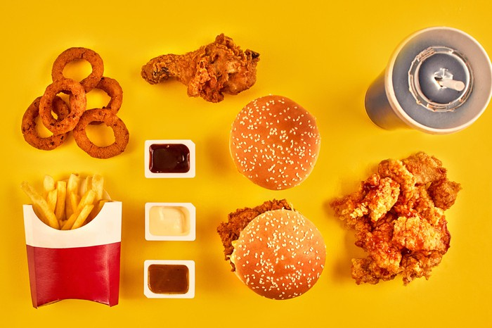 Burgers, fried chicken, fries, onion rings, and cola.