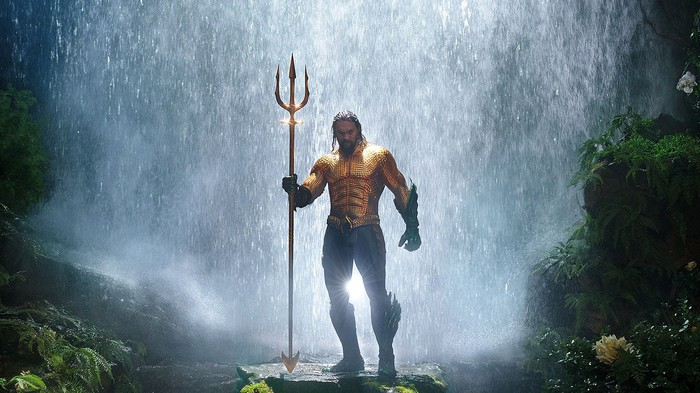 Aquaman in front of waterfall