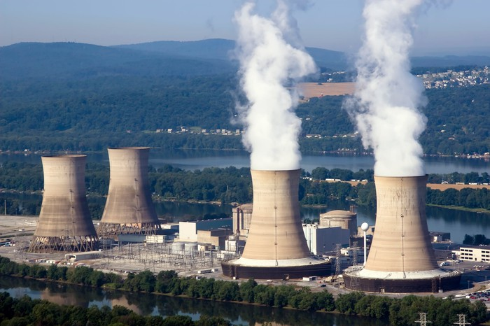 Nuclear power plants with steam rising from them