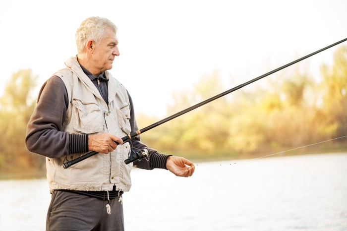 Older man fishing.