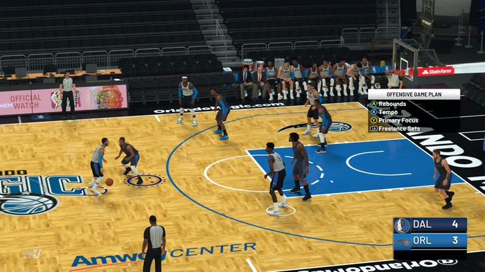 A screenshot of game play from NBA 2K19, showing virtual players on a basketball court.