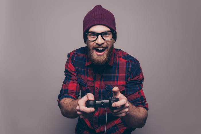 Bearded guy holding videogame controller